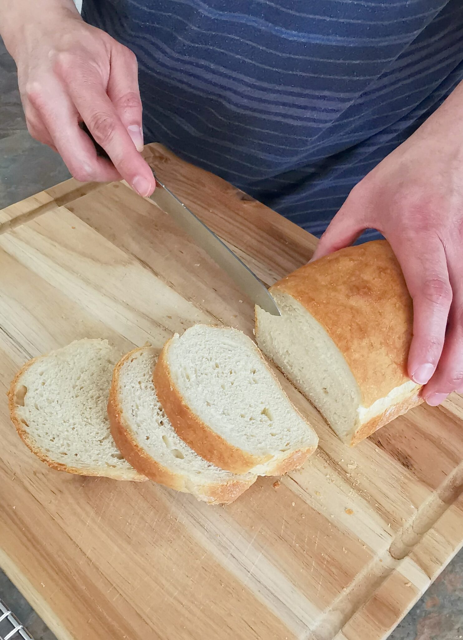 Bread being cut into slices.