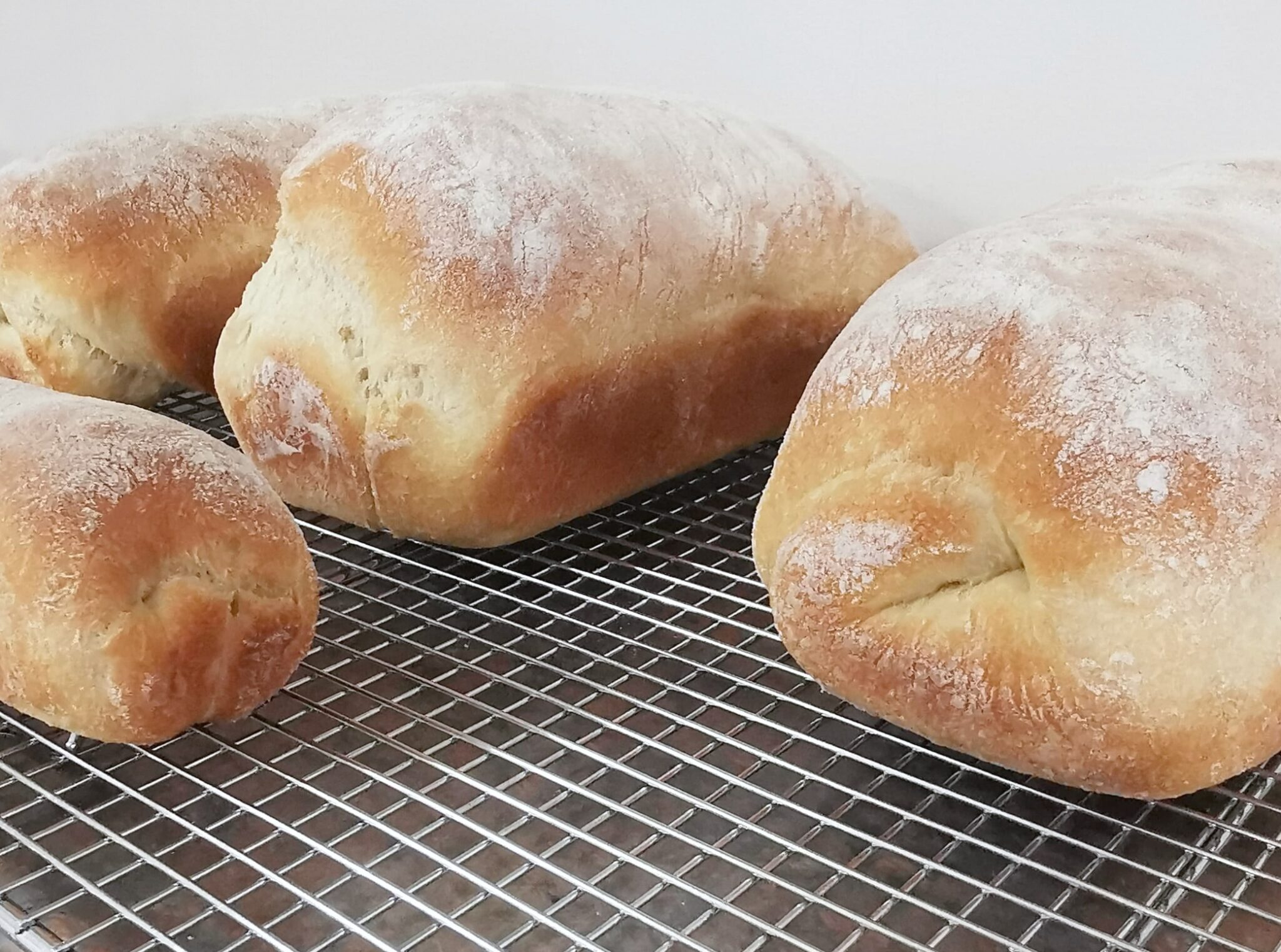 Close up of baked bread loaves.