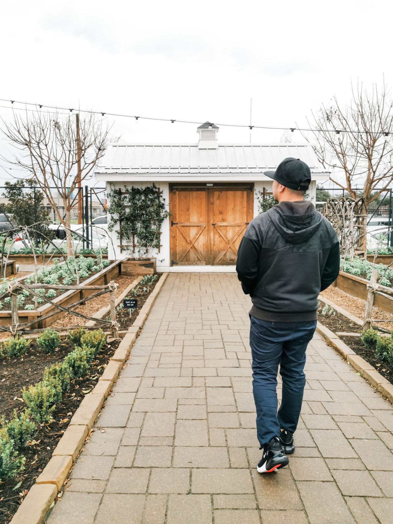 Darasak walks through the Magnolia Seed + Supply garden at Magnolia Market.