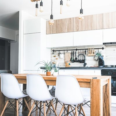 A beautiful modern farmhouse kitchen with white, brown, and grey accents.