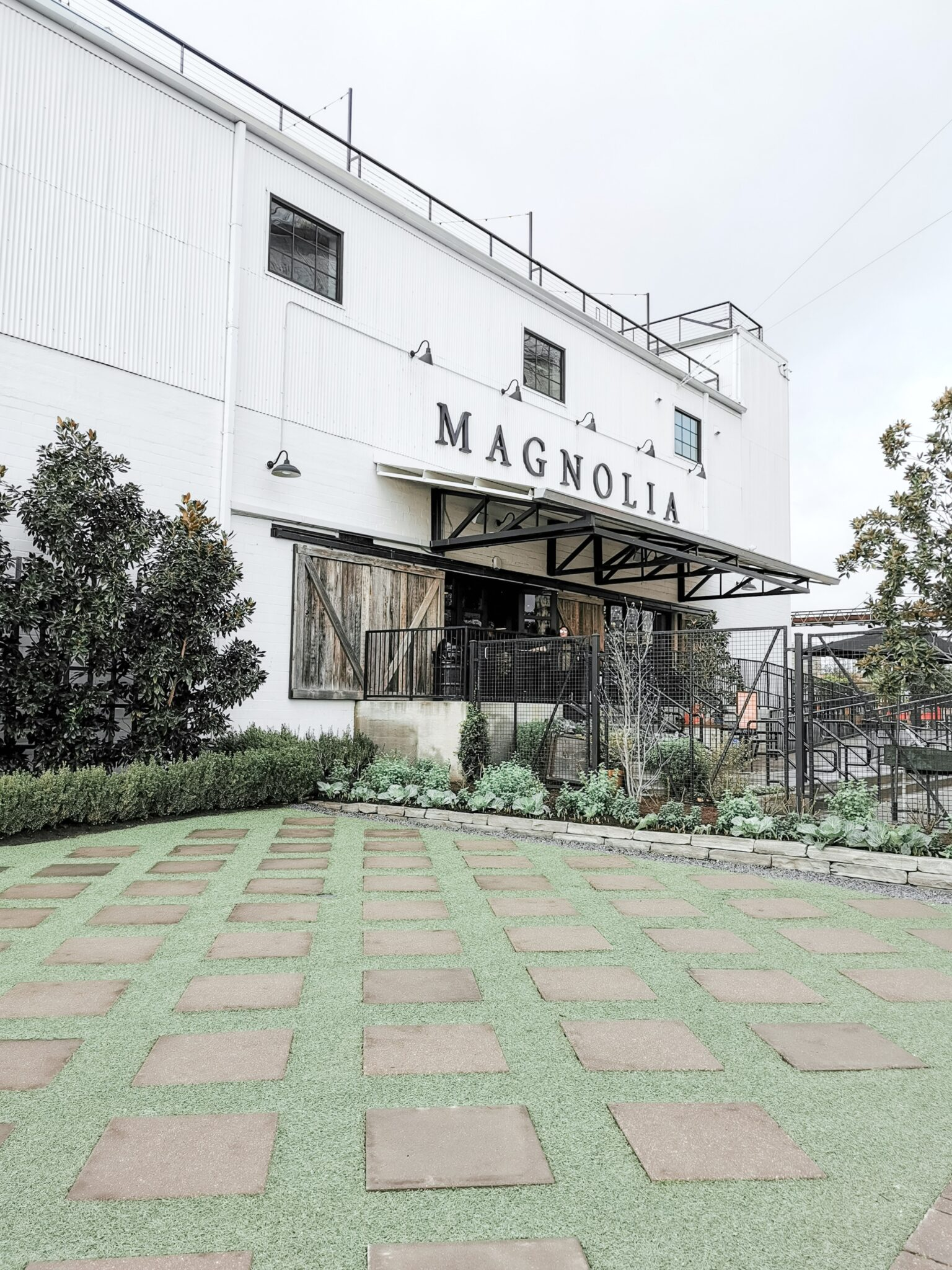 The front of Magnolia Markets, the warehouse where you can go shopping.