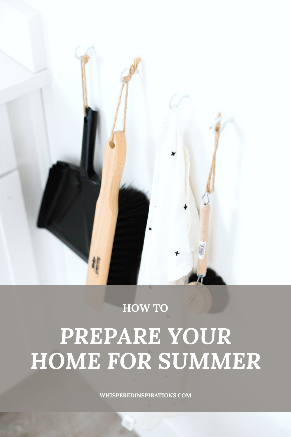 "A white kitchen has hooks with cleaning supplies. This is how to prepare your home for summer. A banner reads, ""How to Prepare Your Home for the Summer."""