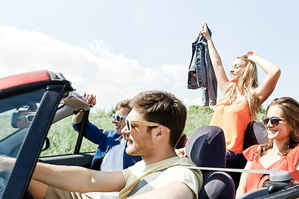 A group of people in a convertible go on a mystery adventure.