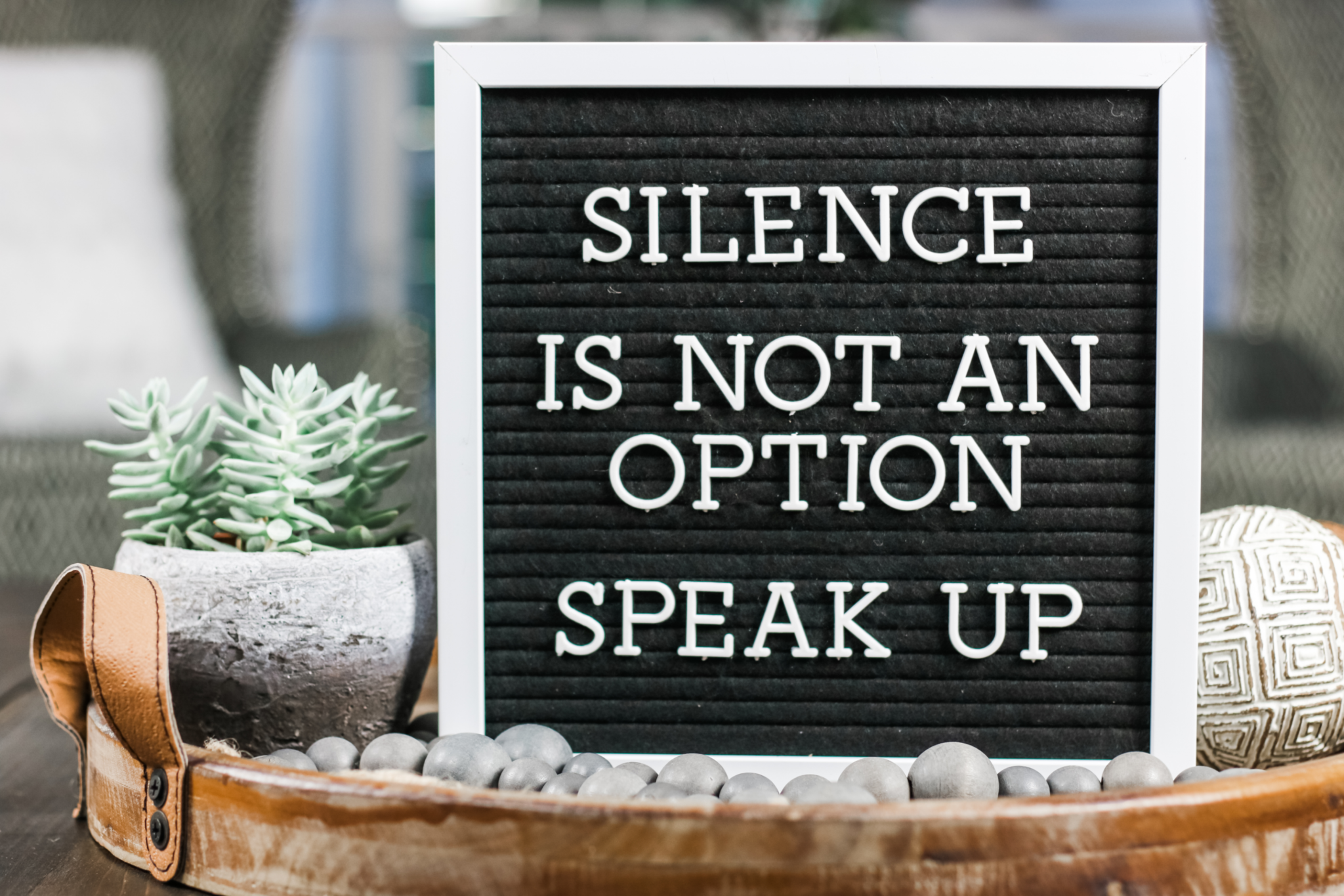 """A sign that states, """"Silence is not an option, speak up."""""""