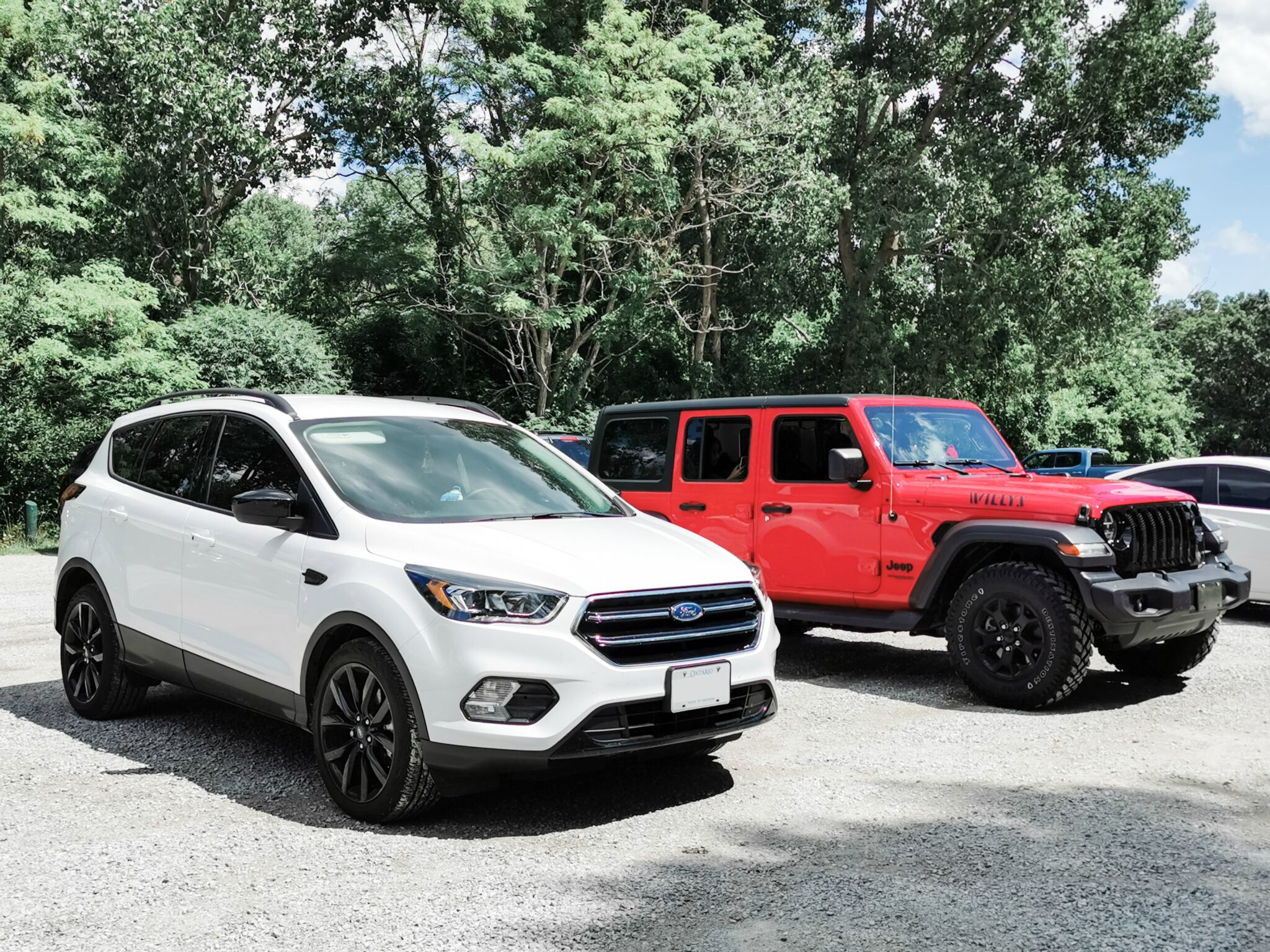 A Ford Escape and a Jeep Wrangler parked at one of Sarnia's beaches.  The jeep is equipped with ProClip USA Jeep accessories.