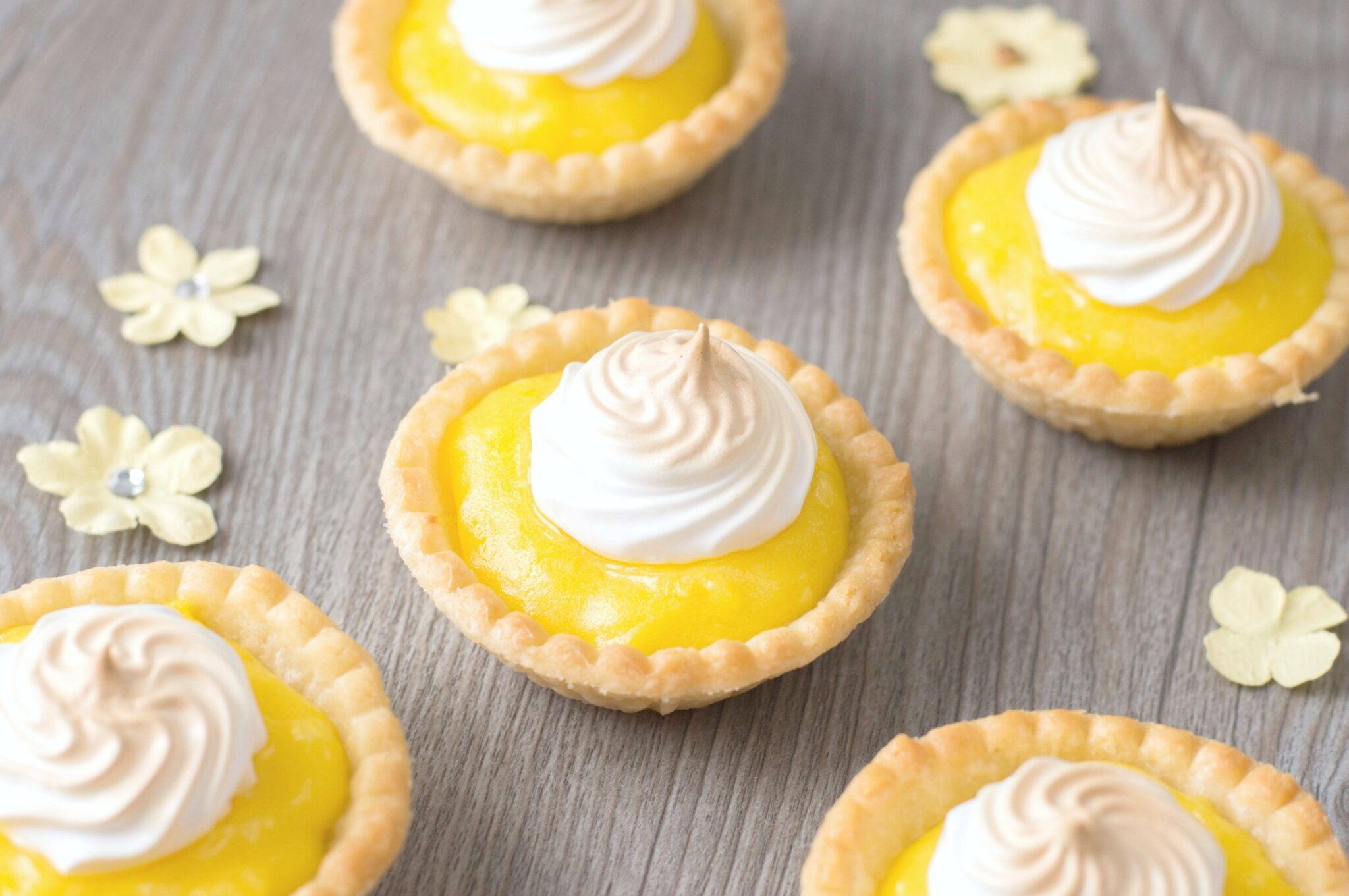 A close up of the Mini Lemon Meringue Tarts with the meringue browned.