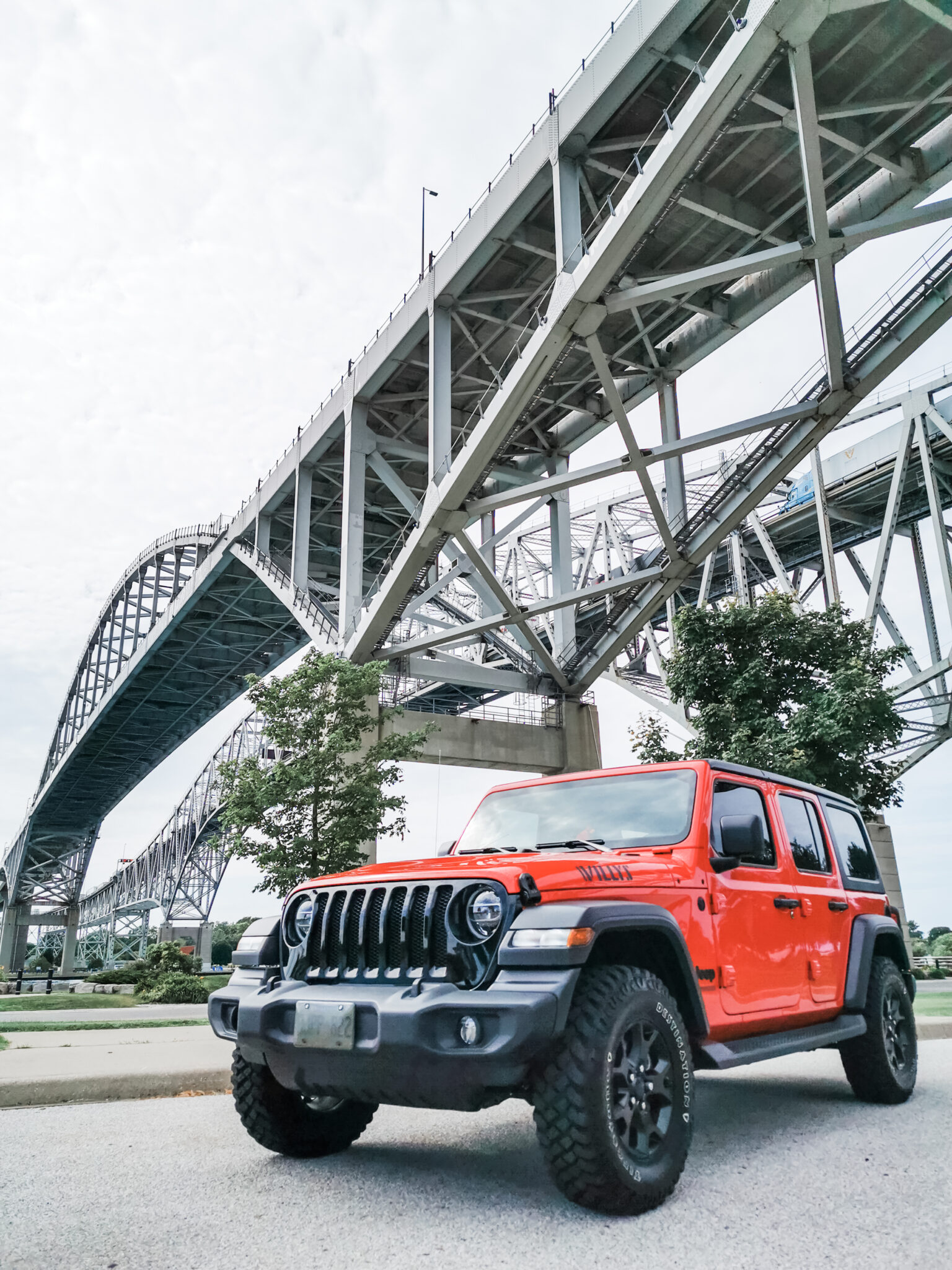 A 2020 Jeep Wrangler is parked in front of the Bluewater Bridge in Sarnia, ON.