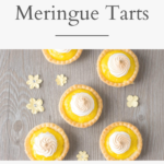 "A banner reads, ""Mini Lemon Meringue Tarts,"" a picture below is a a flat lay picture of the tarts on a grey board."