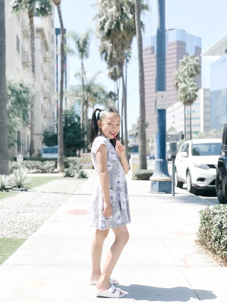 Mimi standing on a sidewalk in Longbeach, California.