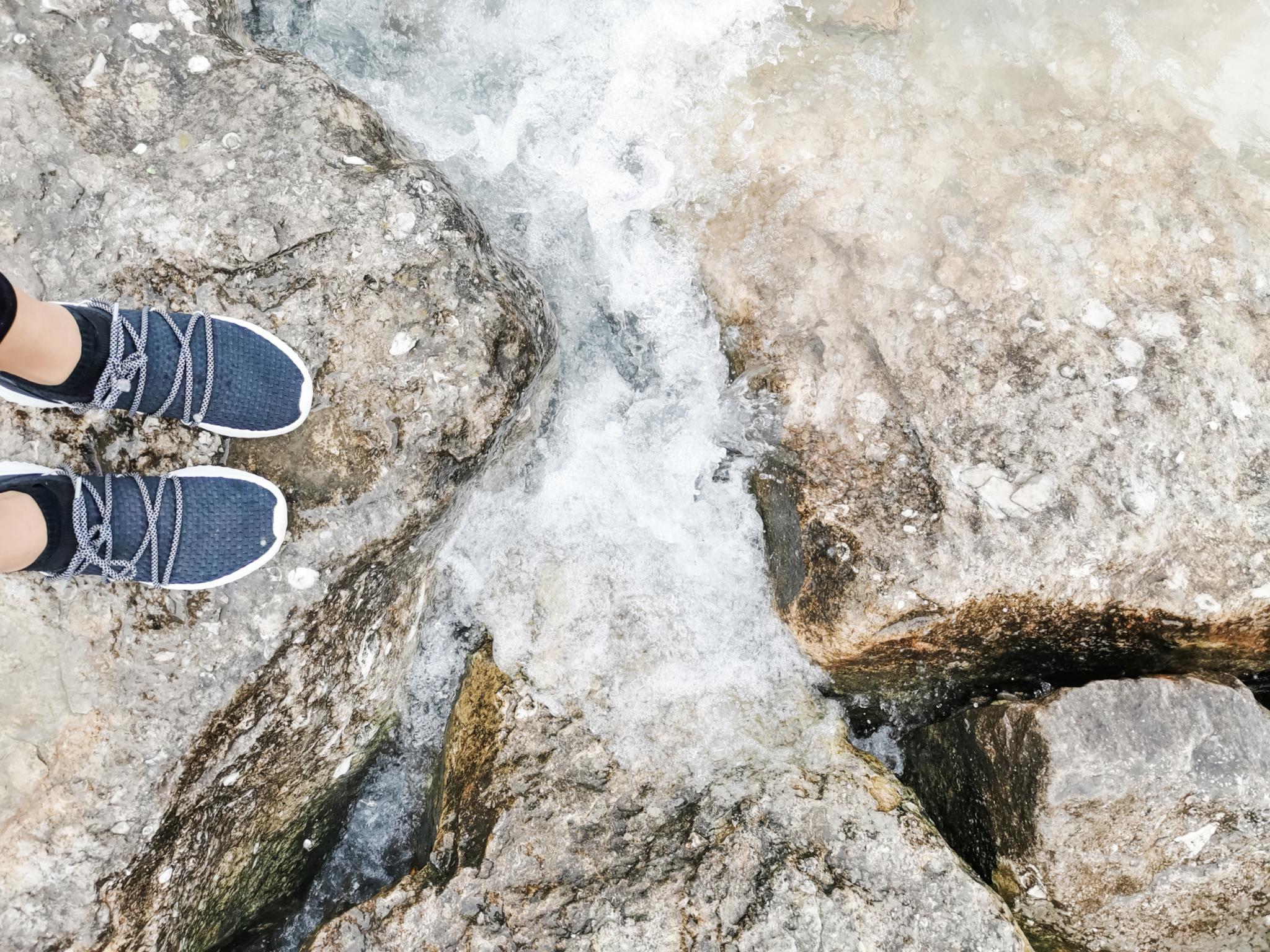 Nancy's feet in between two stones on Lake Huron.