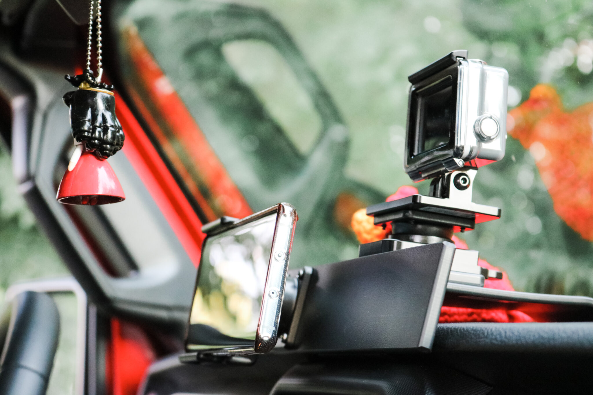 A close up of the ProClip Center Dash Mount, with a standard phone holder, and GoPro Adapter. One of many ProClip USA Jeep Accessories.
