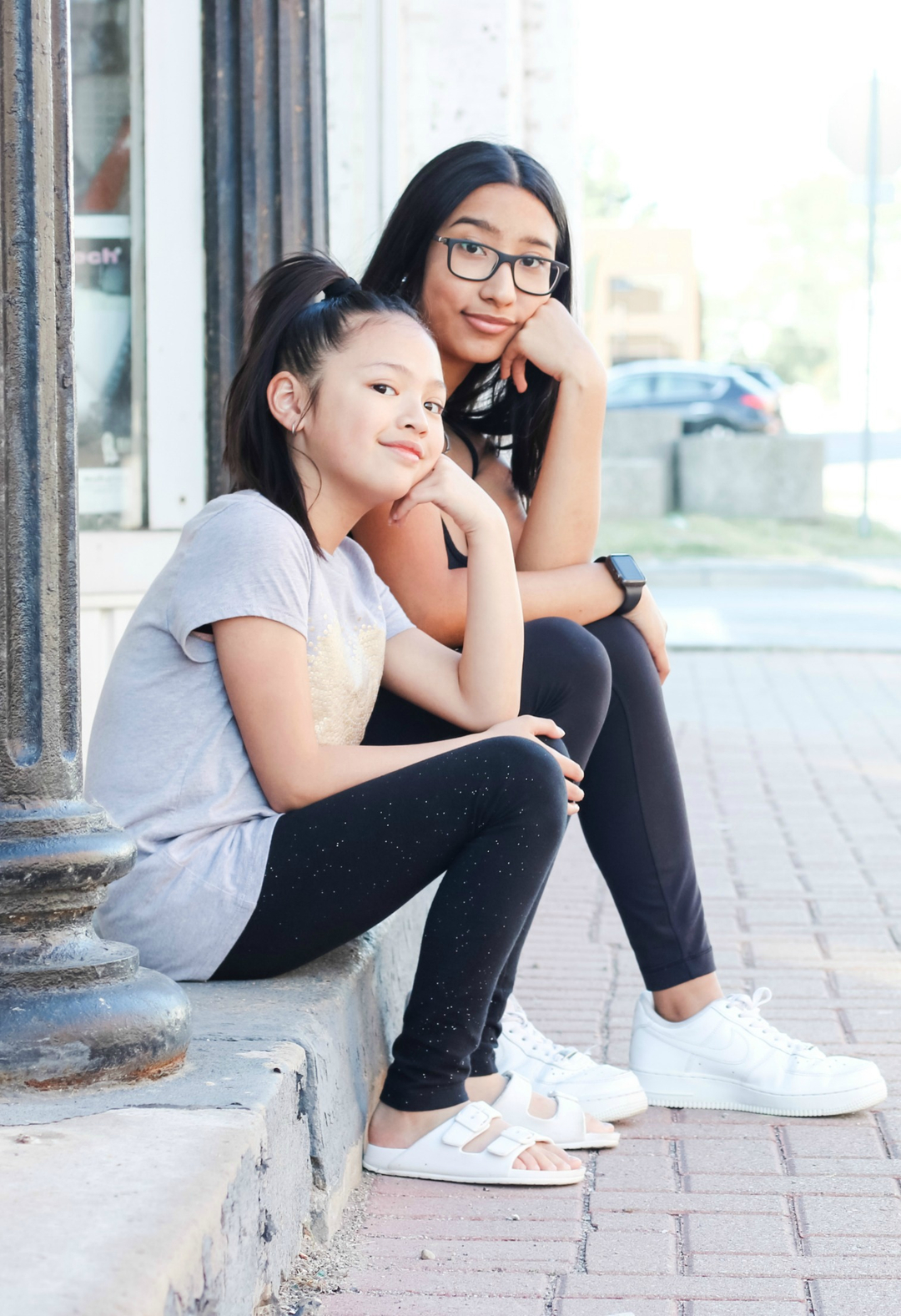 Mimi and Gabby sitting on a step in Amherstburg.