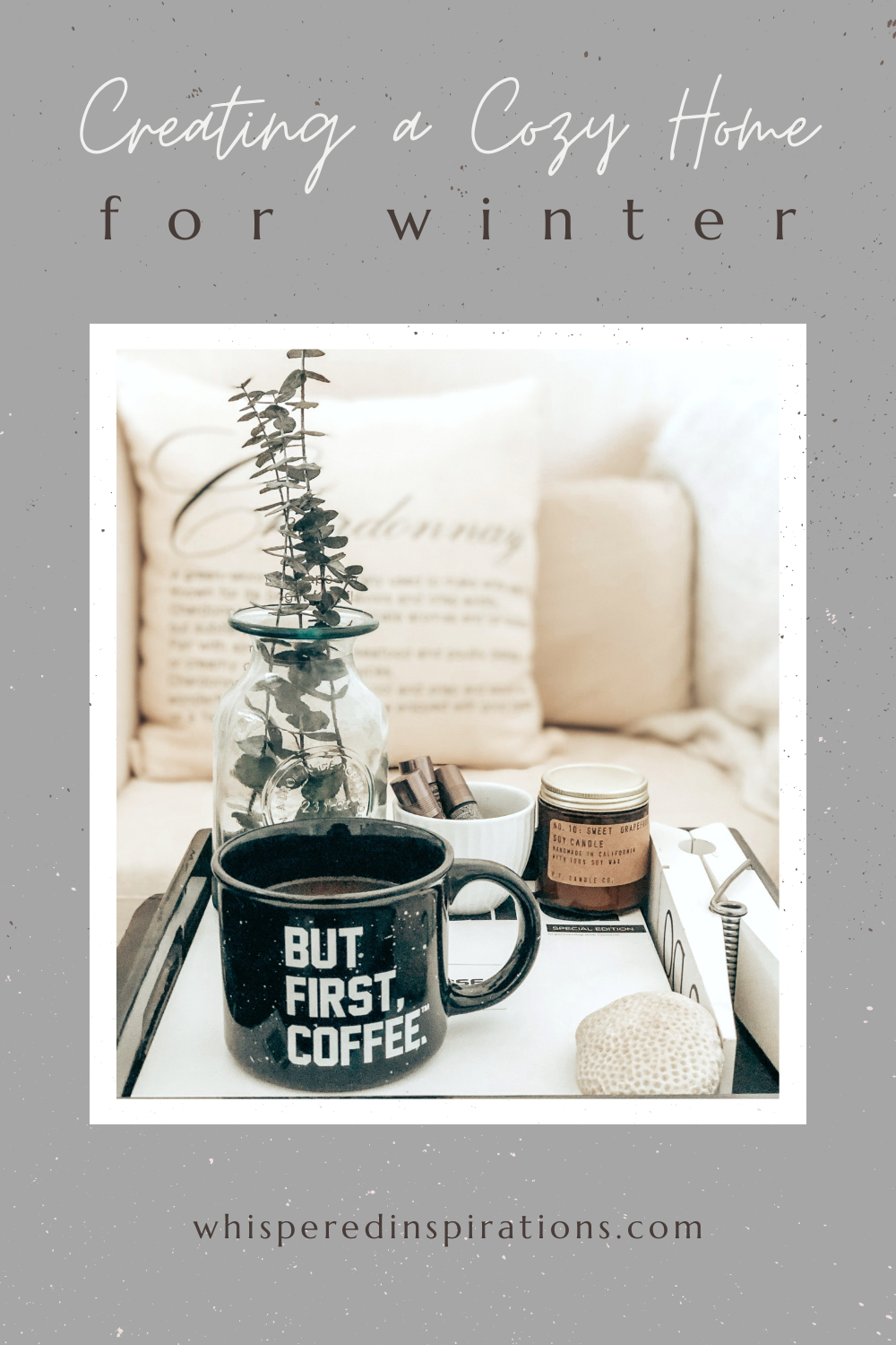 "A banner reads, ""Creating a Cozy Home for the Winter,"" A beautiful and cozy home, a tray with a coffee mug and other creature comforts sits on the coffee table. The mug reads, ""but, coffee first."""