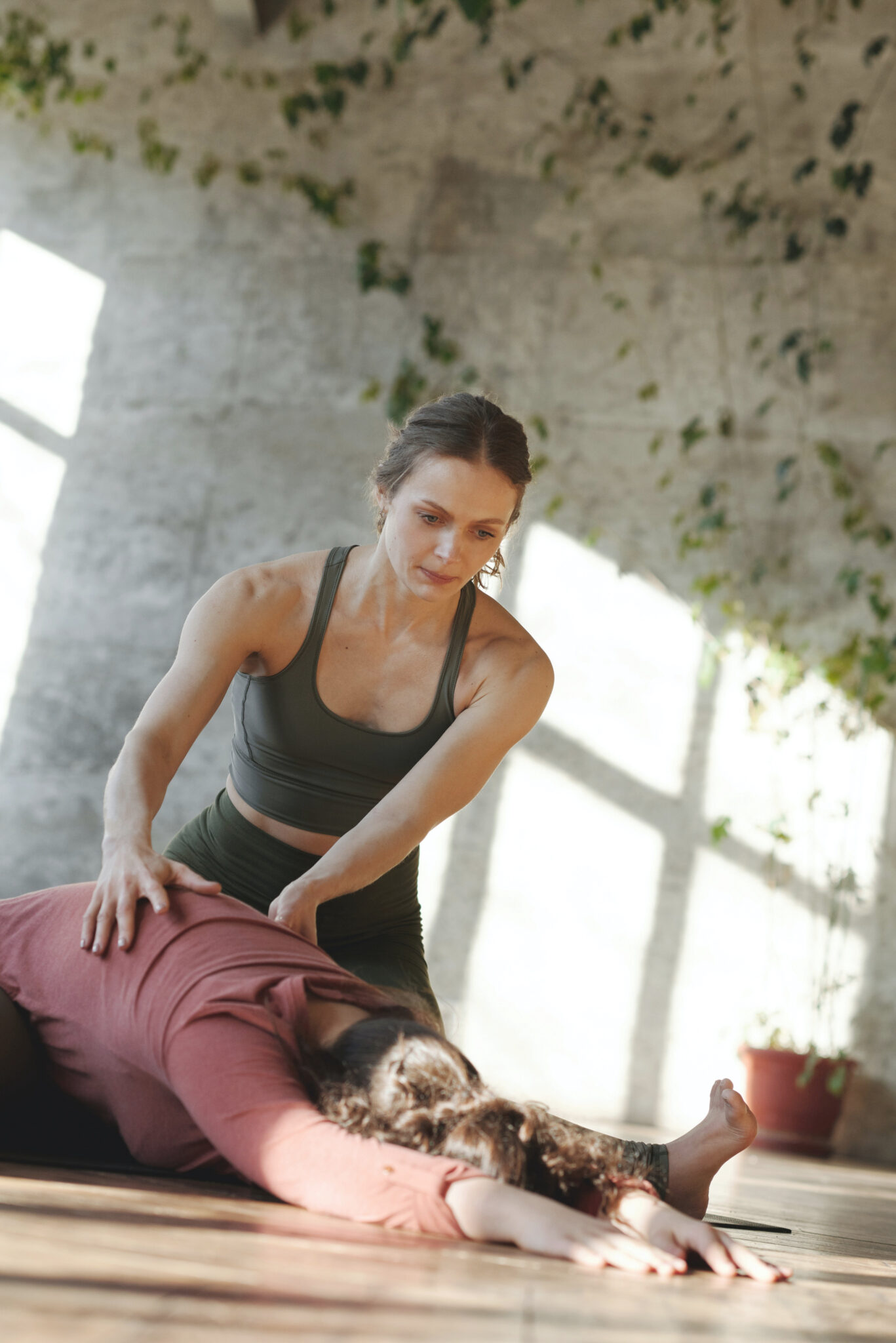 A personal trainer helps a woman stretch and work out for her wedding.