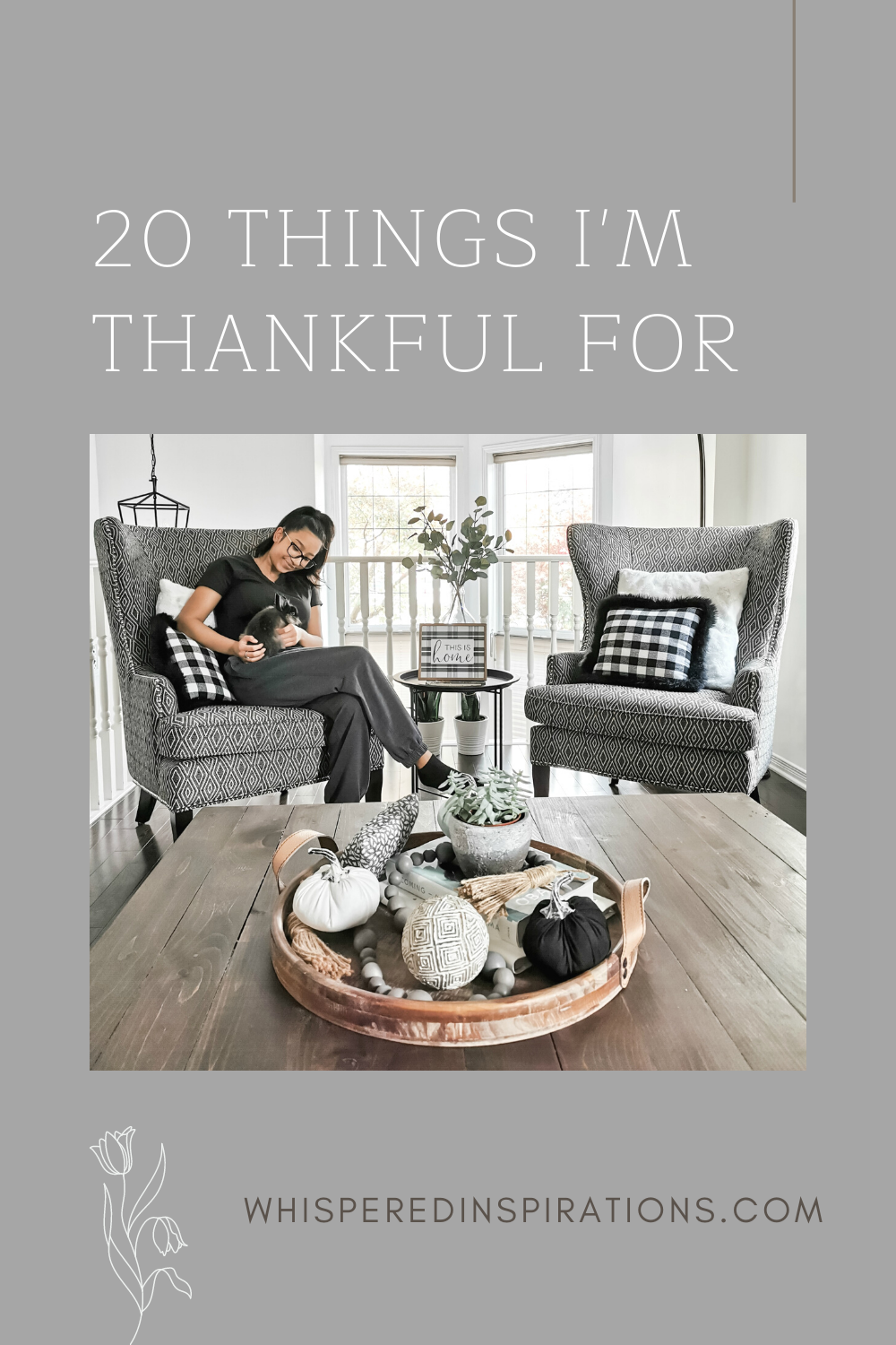 """A banner reads, """"20 Things I'm Thankful For."""" Gabby sits in our living room holding our new bunny Nori."""