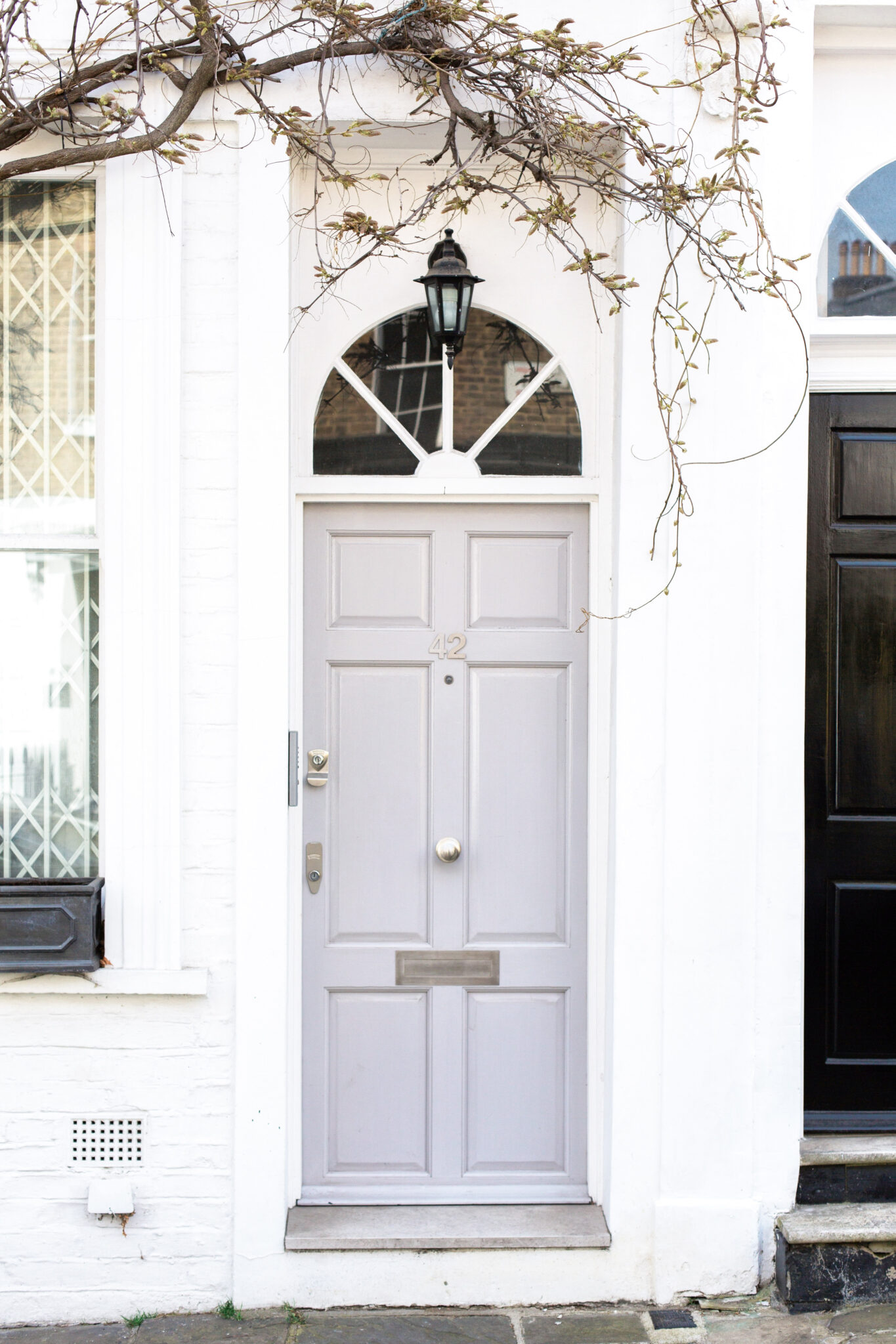 A white building with a grey door. Above the grey door there is an angled window. This article covers tips for when you're ready to sell your property.