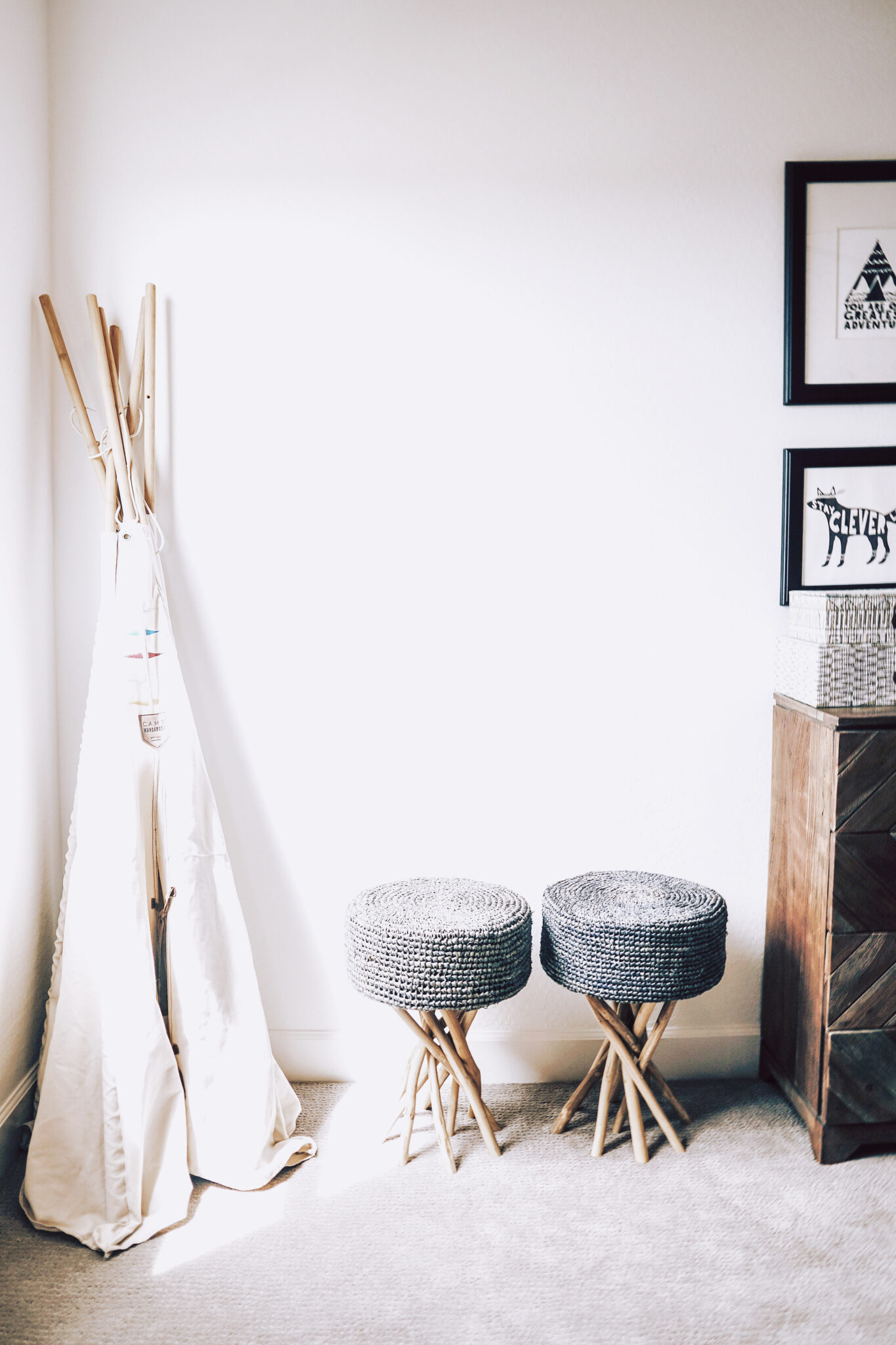 A beautiful boho bedroom. With two stools and storage. This article shows you easy steps to improve you home's value.
