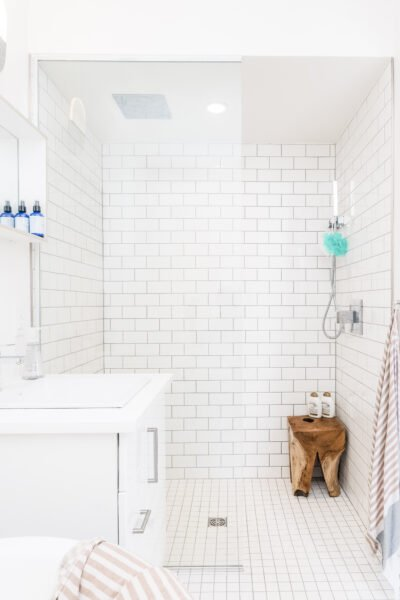 A white and modern bathroom. This article covers how to improve your kitchen or bathroom without spending a fortune.