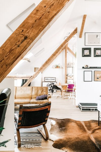 "A beautiful, fully functional living space in the attic. It's filled with light and furniture. This article answers the question, ""should you get an attic conversion?"""