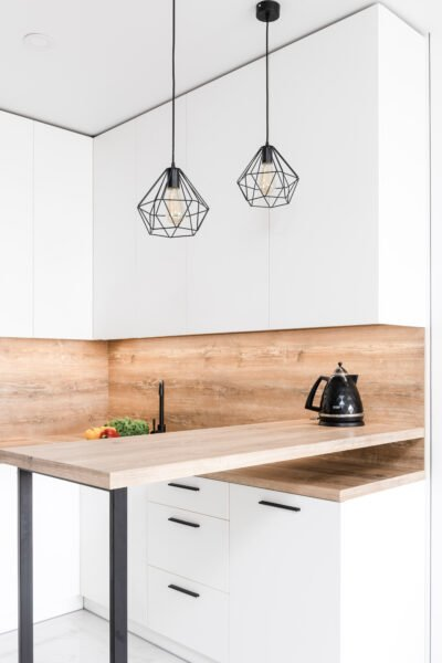 A beautiful white and oak kitchen. This article covers 4 practical ways to make your kitchen more appealing.