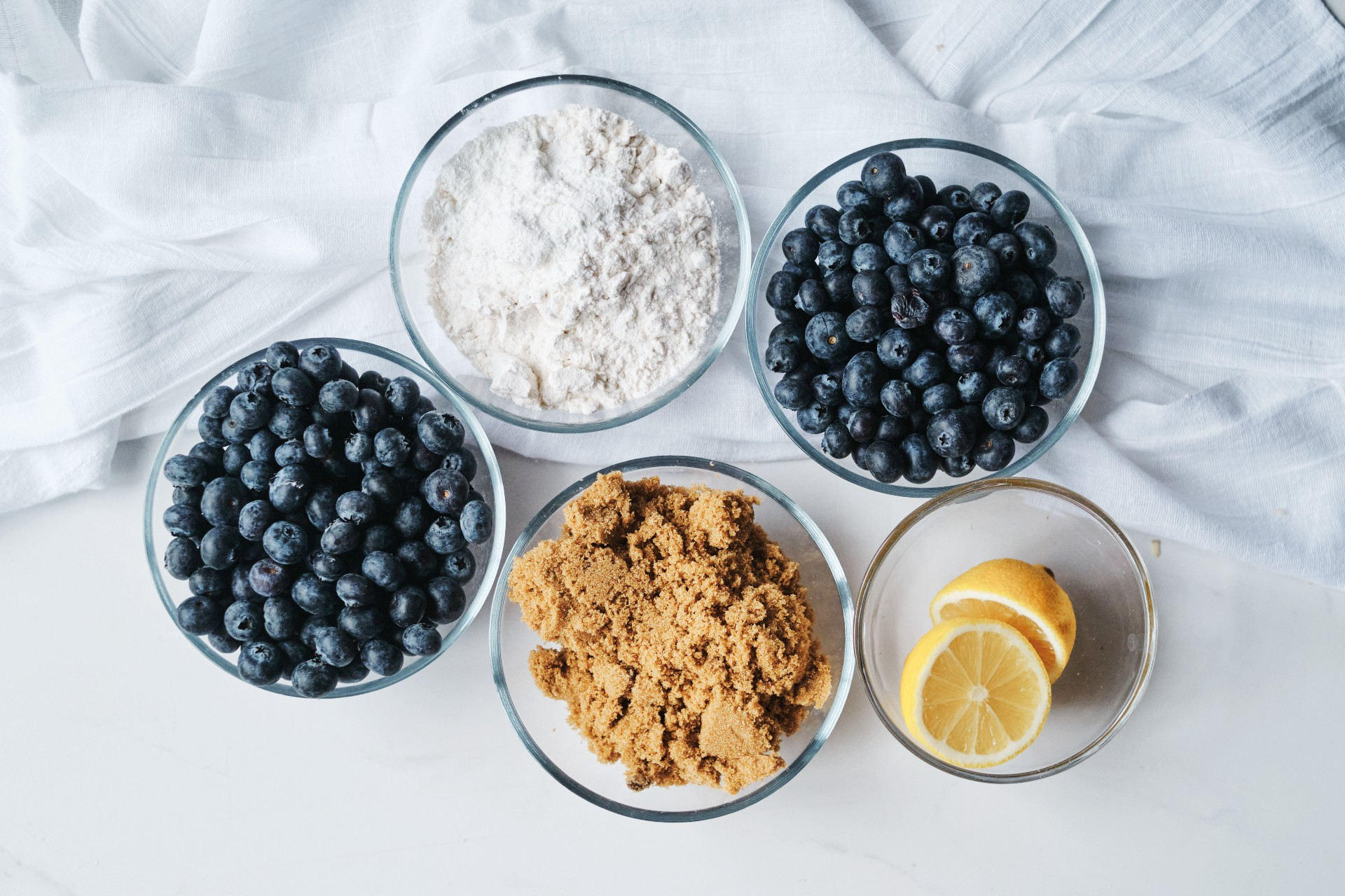 A flat lay of all the ingredients needed for the blueberry crumble pie recipe.