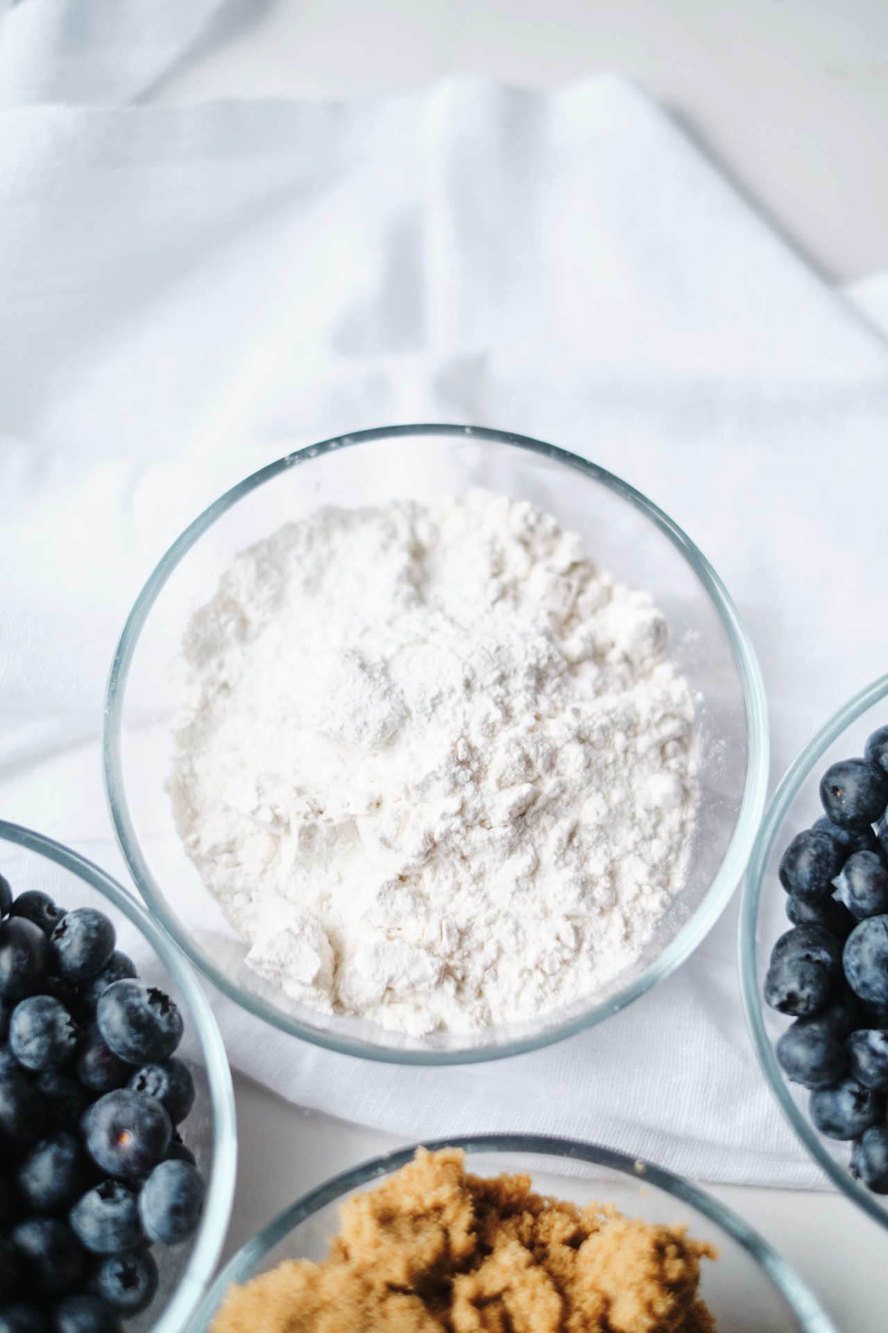 A close up of flour and other ingredients needed for the pie.