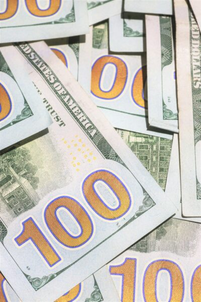 """A close up of 100 dollar bills. This article covers, """"When Does a Payday Cash Advance Make Sense?"""""""